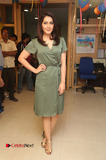 Actress Raashi Khanna Stills in Green Short Dress at Mirchi 95 Suno Aur Mercedes Jeeto Contest  0187.JPG