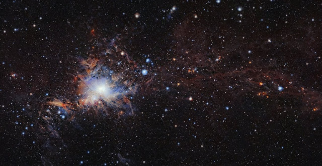 This image from the VISTA infrared survey telescope at ESO's Paranal Observatory in northern Chile is part of the largest infrared high-resolution mosaic of Orion ever created. It covers the Orion A molecular cloud, the nearest known massive star factory, lying about 1350 light-years from Earth, and reveals many young stars and other objects normally buried deep inside the dusty clouds.  Credit: ESO/VISION survey