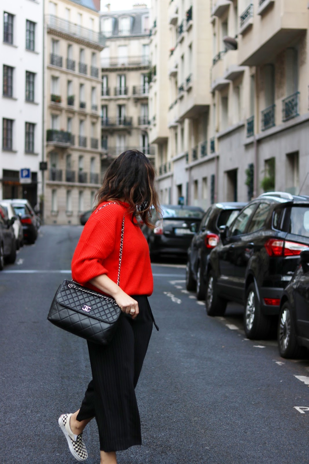 red hm sweater outfit le chateau pinstripe pants paris travel outfit vans checkered slip ons
