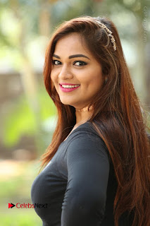 Actress Aswini Latest Stills in Black Denim Jeans  0145.JPG