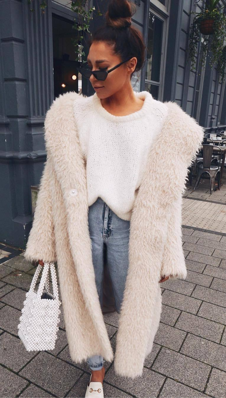 how to style a knit sweater : pearl bag + jeans + coat + loafers