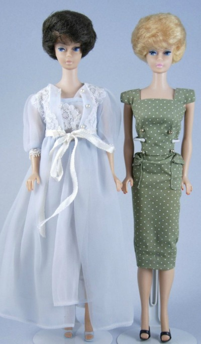 Two bubble cut Barbies. One wearing blue negligee and one in polka dot sheath dress