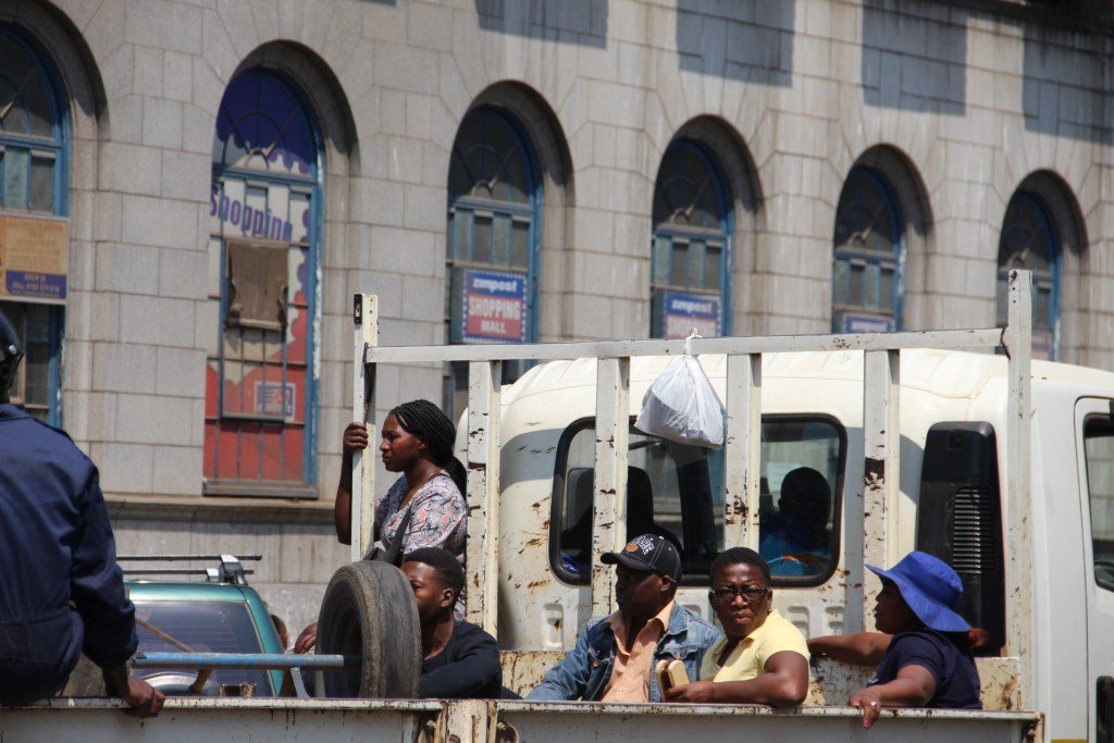 Watch These Pictures: Chaos As Police, Vendors Clash In Harare