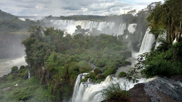 the breadth of Iguazu falls from a side angle