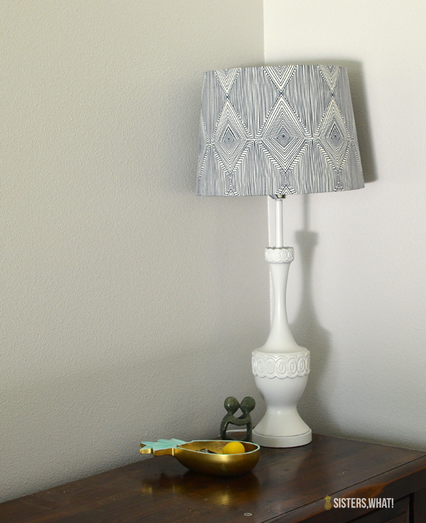 Thrift a lamp and spray paint and cover shade in fabric! so easy!