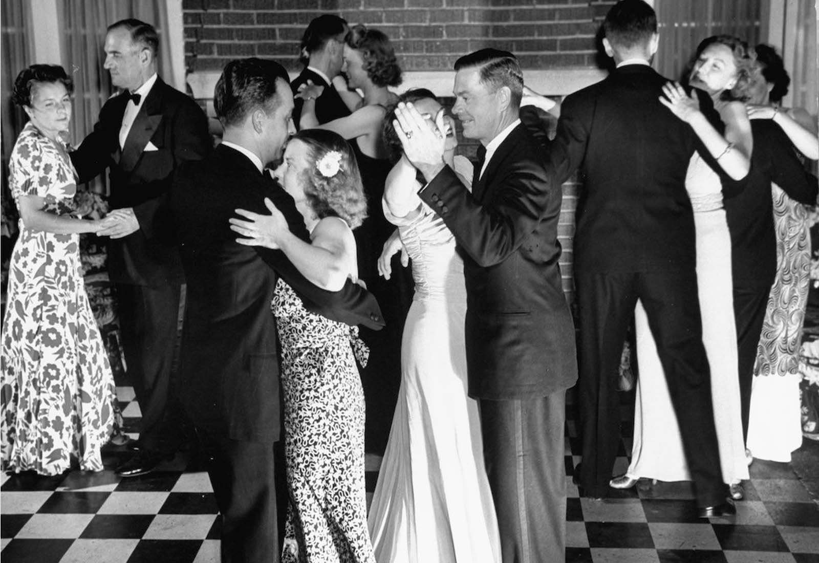 Jane dancing with her husband Gilbert (third from left) amidst other couples at their country club's formal dance.