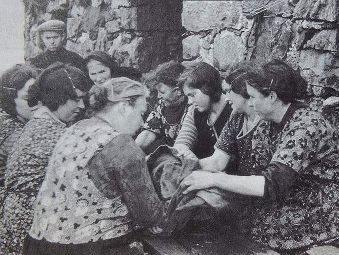 1930's Eriskay, Western Isles - waulking tweed - wearing house dresses.