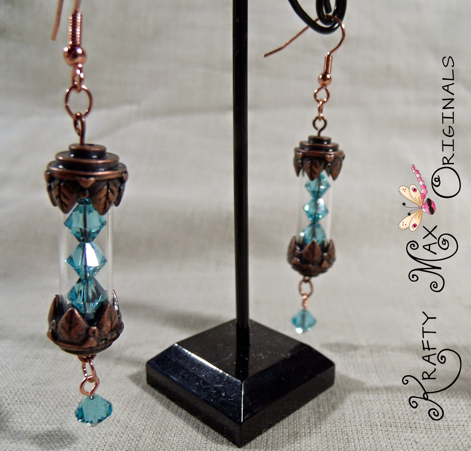 http://www.lajuliet.com/index.php/2013-01-04-15-21-51/ad/dangle,19/exclusive-teal-swarovski-crystal-earrings-a-krafty-max-original-design,345