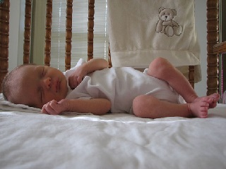 Image: Nicholas in the crib, by Inga Munsinger Cotton (IngaMun) on Flickr