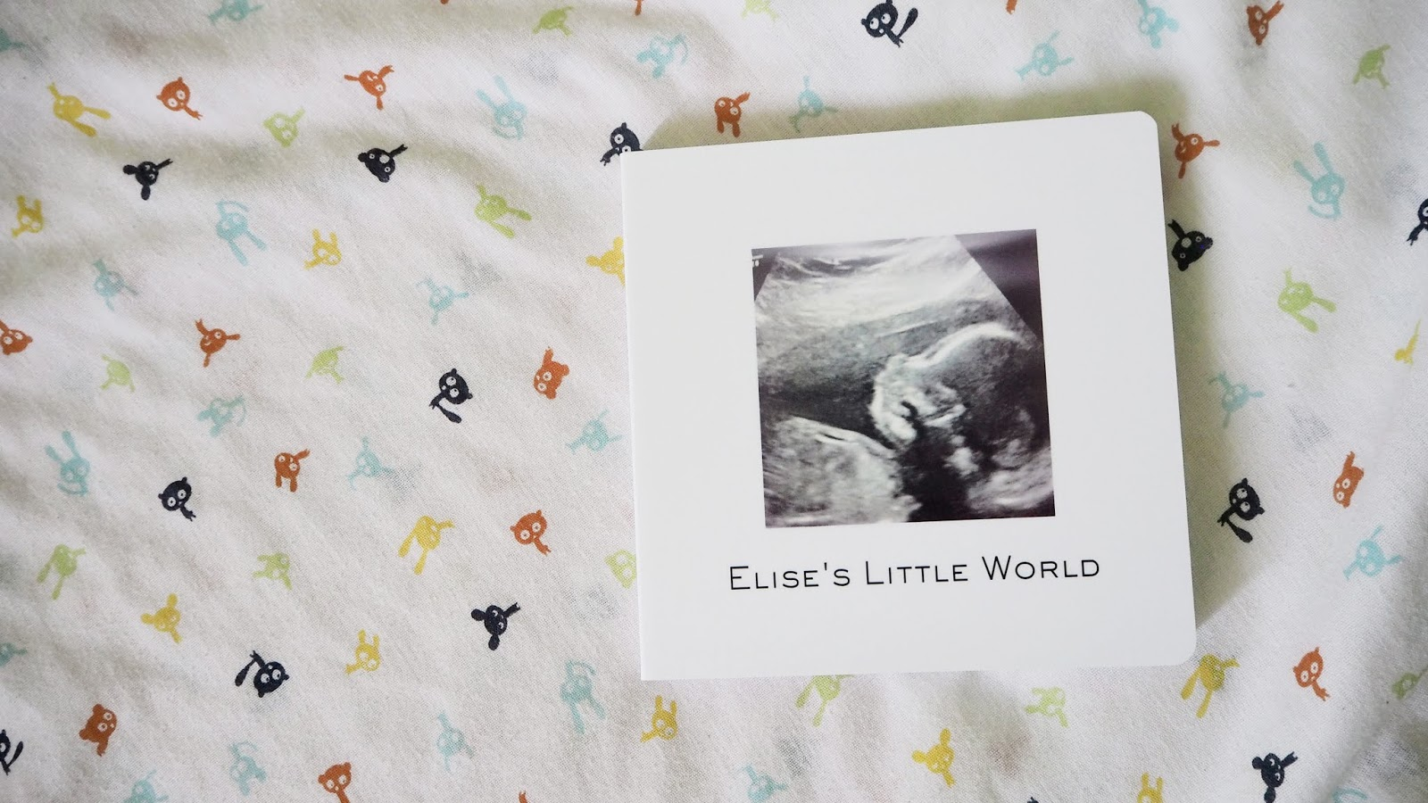 The photo book can be seen on a white background with little animals
