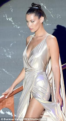 2 - Two wardrobe malfunctions in one night; Bella Hadid flashes her underwear and some skin in two dresses with crotch-high slit