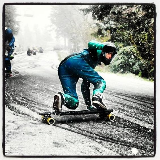 Downhill longboarding in the snow