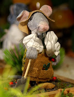 Miniature Modle of a mouse working in the gardens of Pebble Cottage
