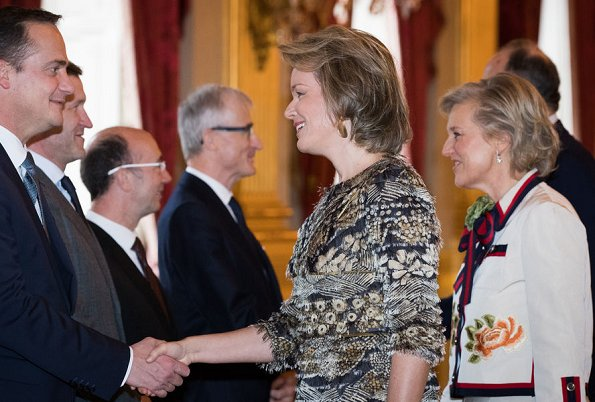 Princess Astrid wears Gucci skirt suit. Queen Mathilde and Princess Astrid attended a New Year's reception