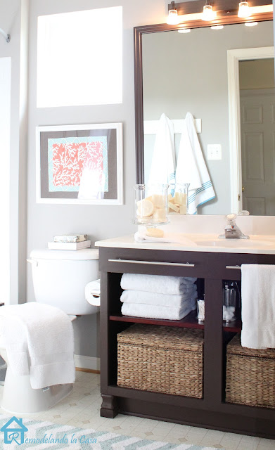 bath makeover with baskets in vanity, teal and white rug