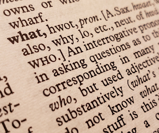A close up of an old Webster's Dictionary entry for the word what