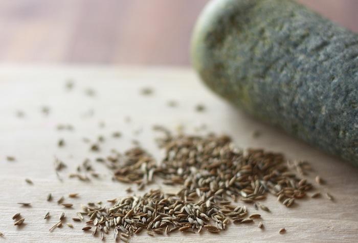 cumin seeds and mortar and pestle