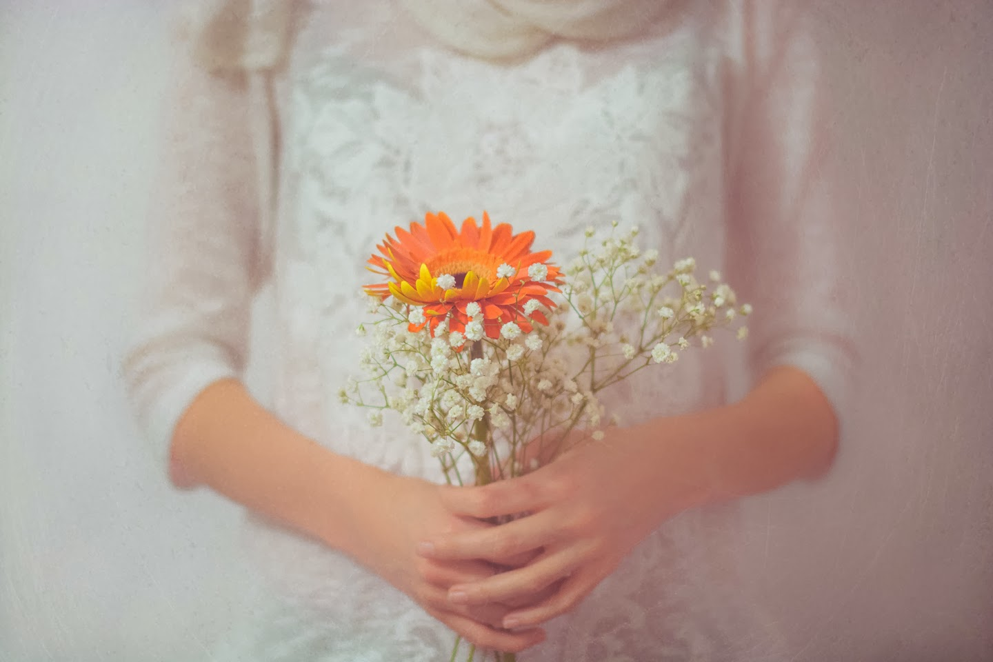 Tender soft look, vintage photography of a girl holding a flower