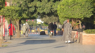 People with Djellaba along the streets in morocco