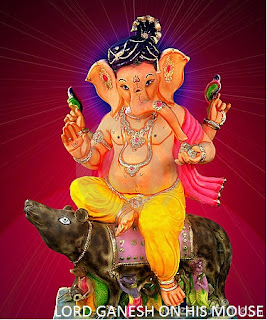 lord ganesh on his mouse