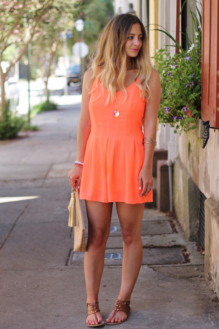 Neon Orange Romper with Gold pendant necklace