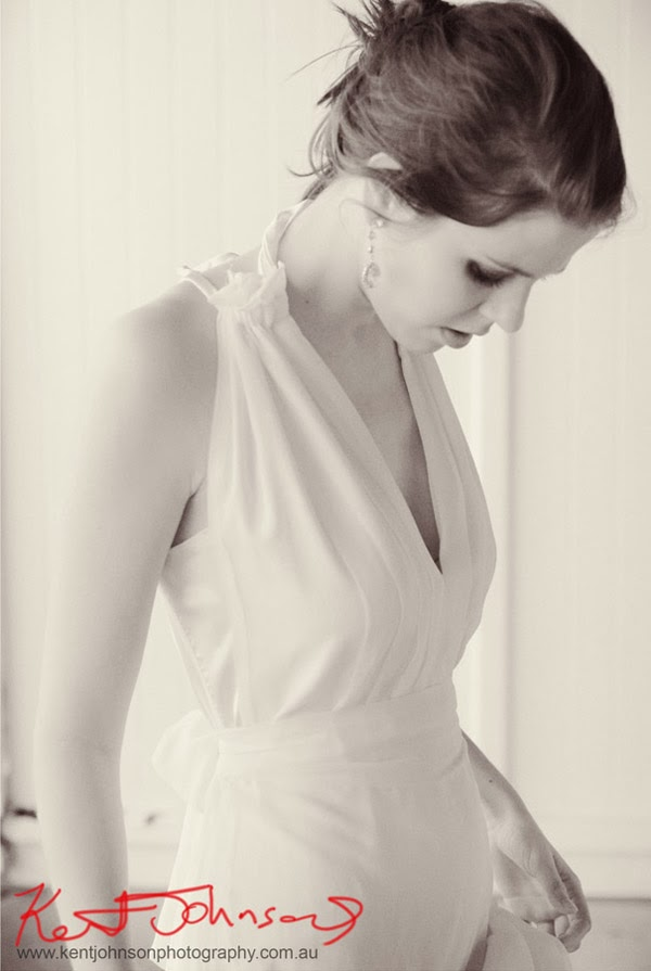 White halter neck Wedding dress, atmospheric mid shot fashion portrait in black and white. Photographed by Kent Johnson.