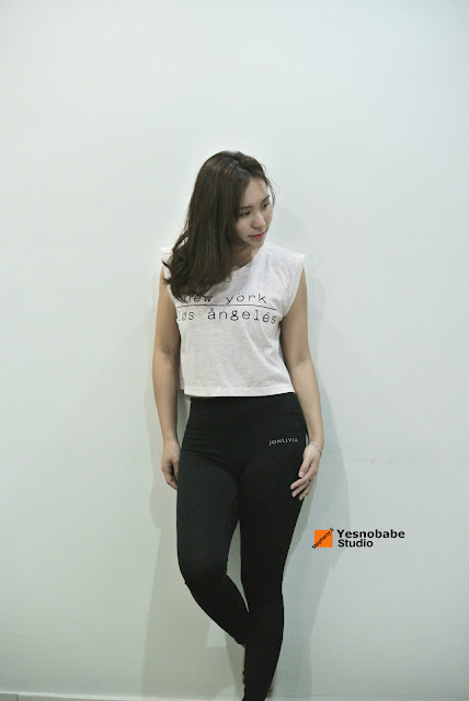 Studio photography of Stepheny Siew in the Jonlivia Compress pants