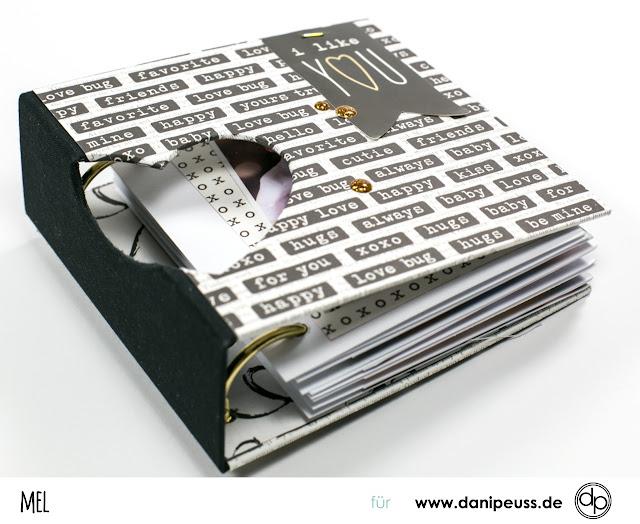 https://danipeuss.blogspot.com/2018/01/minialbum-mit-fenster-und-integrierten-buchringen-anleitung-februarkit.html
