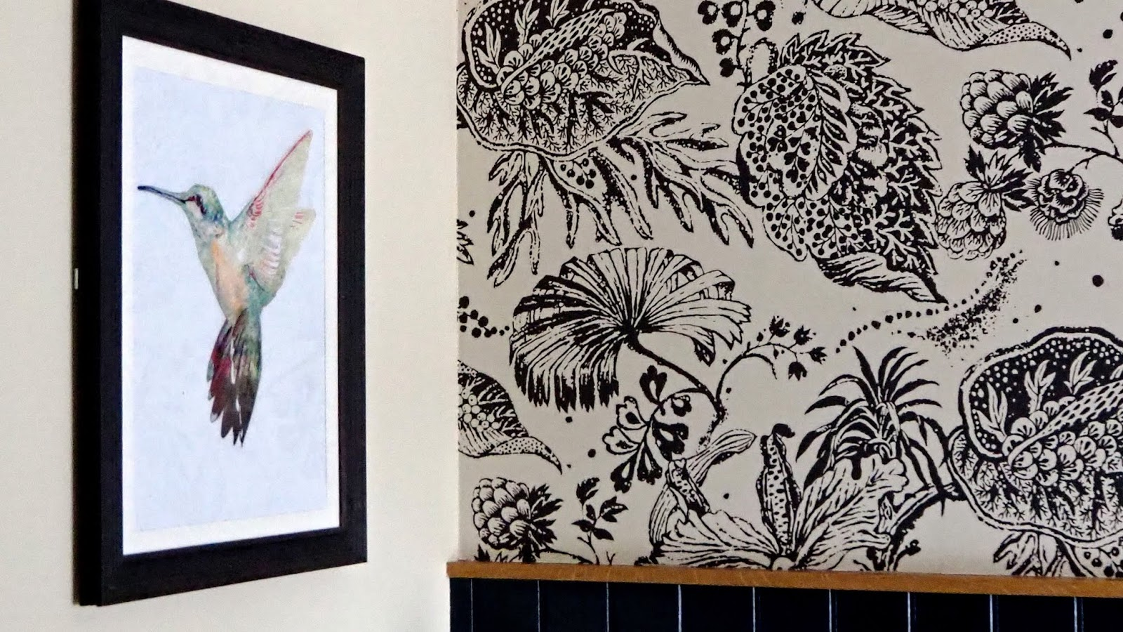 hummingbird painting and floral wallpaper