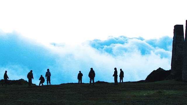 eight teen soldiers on a mountaintop