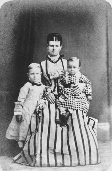 Mother and two children posing for a portrait, Ipswich, 1870-1880