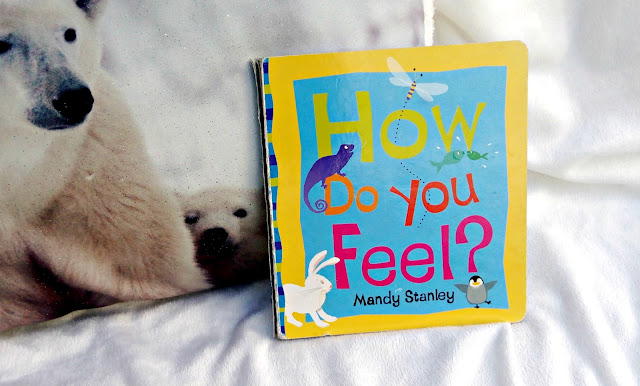 How Do You Feel? book, resting on a white blanket.