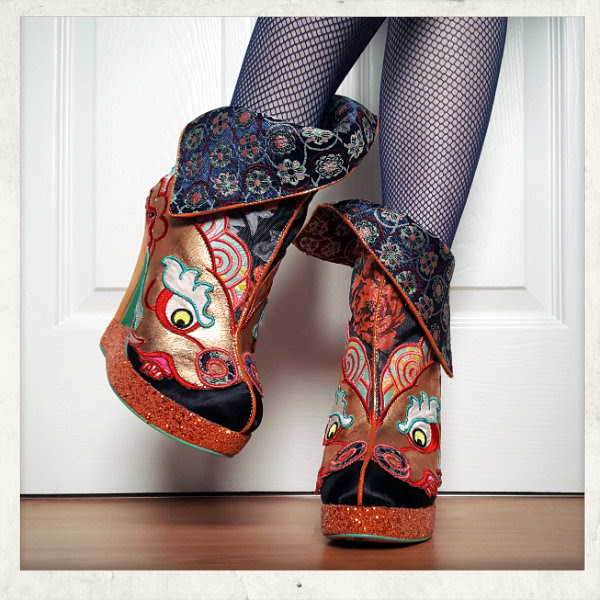 Irregular Choice Tatsu ankle boots on feet with flicked cuff