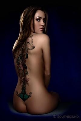 Boobs on back tattoo