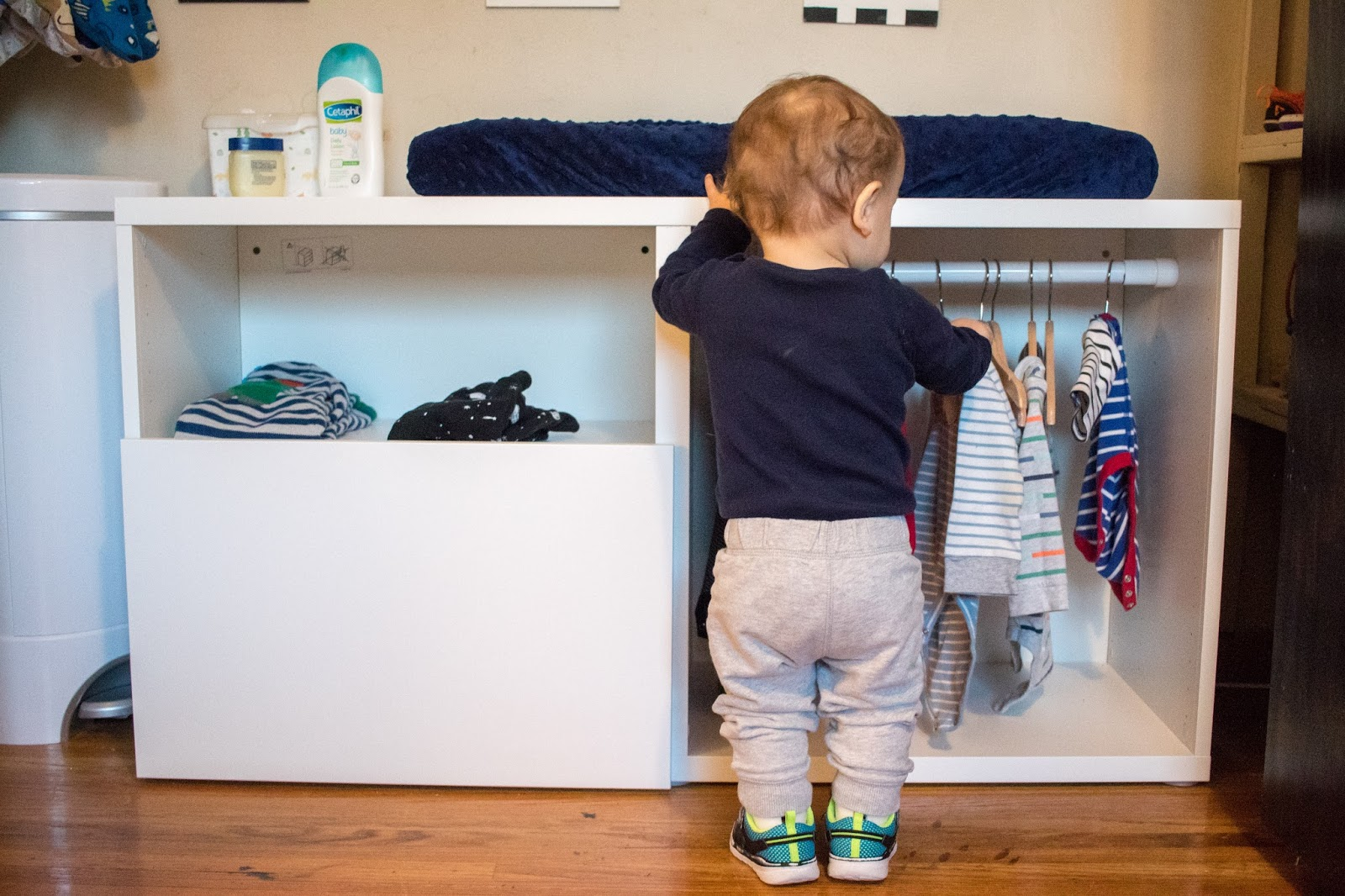 A DIY Montessori toddler wardrobe made with IKEA BESTA shelving
