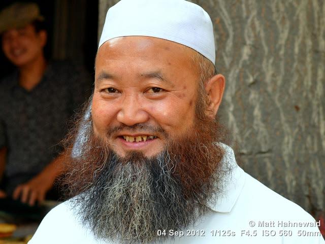 street portrait, headshot, China, Xi'an, Hui Muslims, Hui Muslim man, taqiyah, white skullcap, kufi, Muslim beard