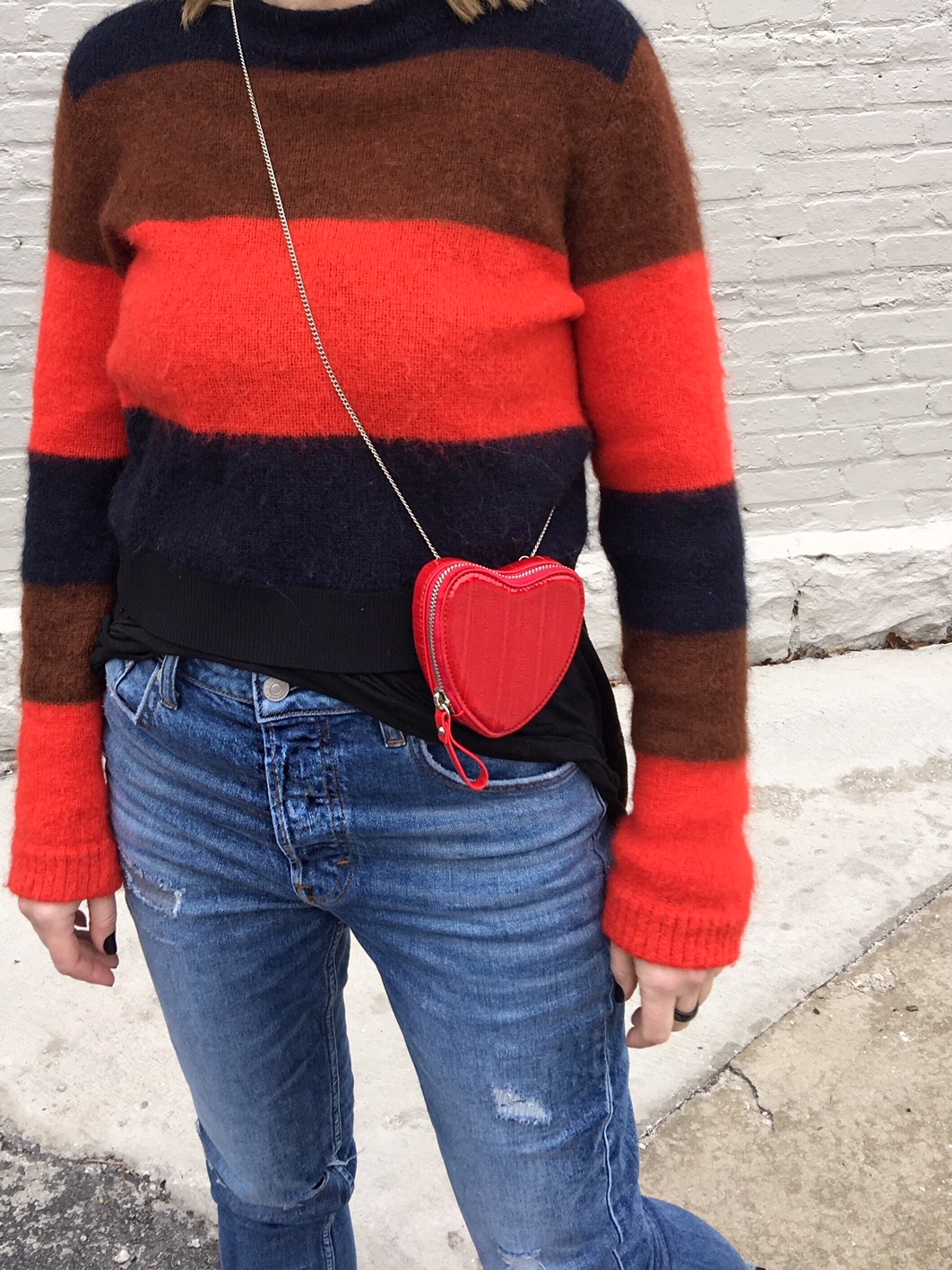 A red striped sweater and a heart shaped bag for Valentine's Day