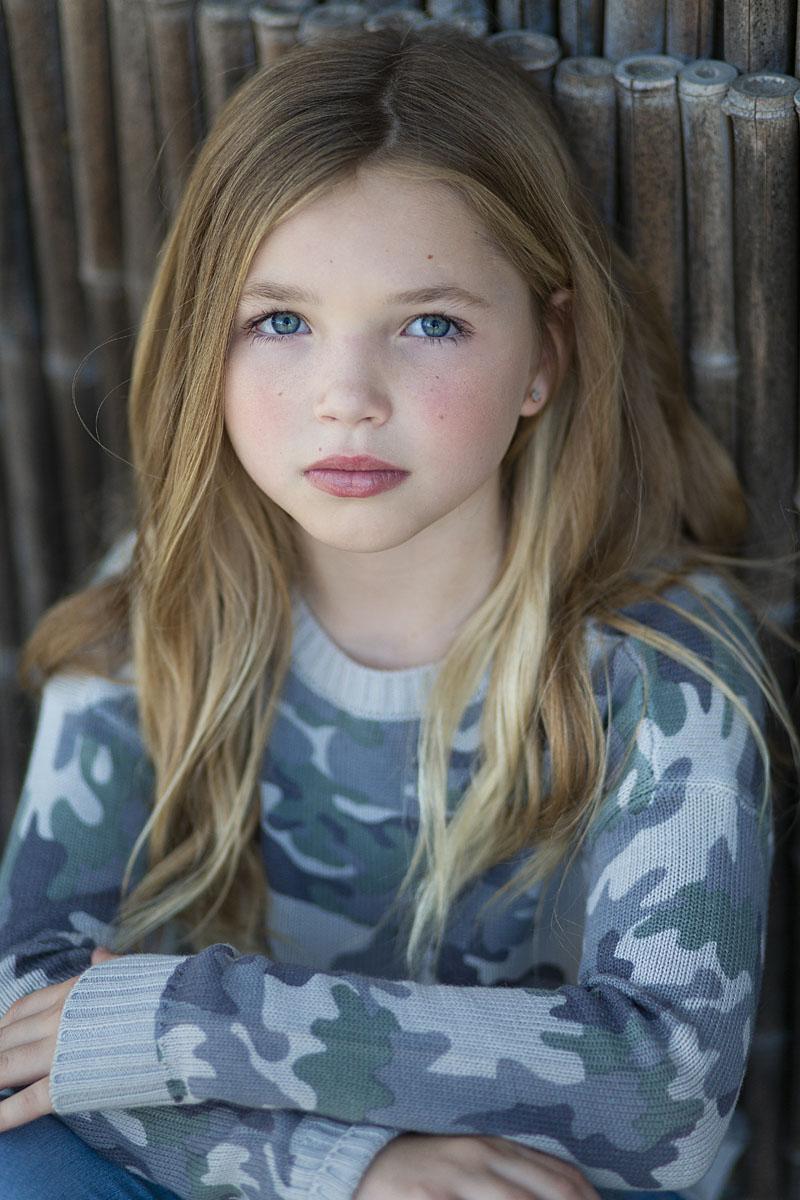 beautiful chilc model wearing Graffiti Gloss camo sweater