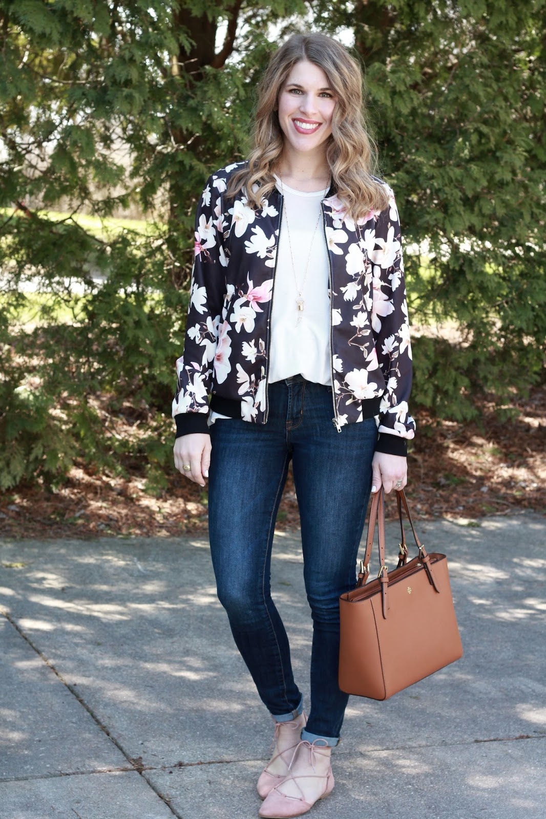 floral bomber jacket, rockstar jeans, blush lace up flats, tory burch tote