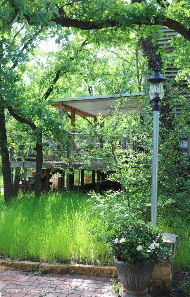 Spring porch above green meadow backyard