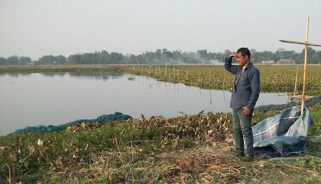 Image: Writer of this blog, Mithu Das, watching birds in Vereki Veel, one of the famous wetlands of Majuli.