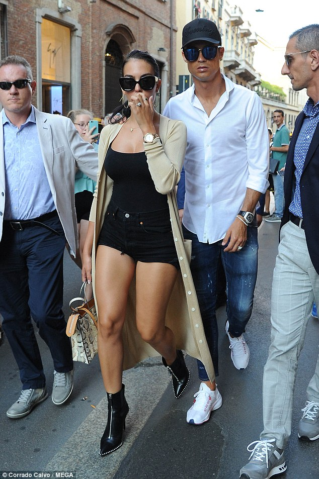 Cristiano Ronaldo and girlfriend Georgina Rodriguez walk hand-in-hand as they step out in Milan