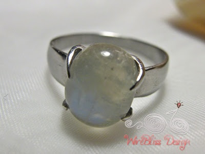 close up of handmade moonstone prong ring