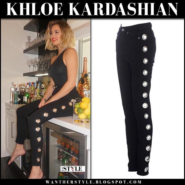 Khloe Kardashian in black grommet eyelet jeans Good American celebrity jeans