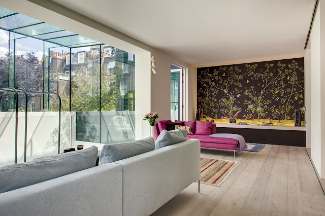 Picture of modern living room interior with dark brown wall and pink sofa