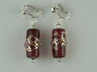 http://www.thecliponearringstore.com/fancy-red-lamp-work-glass-bead-clip-on-earrings.html