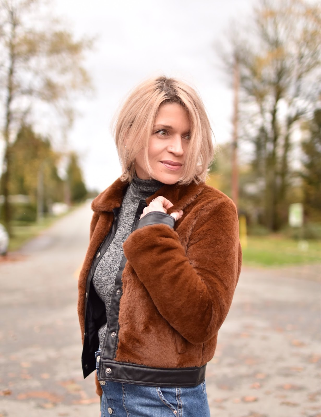 Monika Faulkner outfit inspiration - faux-fur bomber jacket, grey marled turtleneck sweater