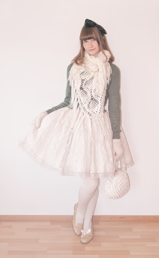 a lolita posing in a white and green outfit