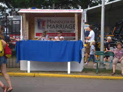 Minnesota for Marriage booth, two women sitting behind the table