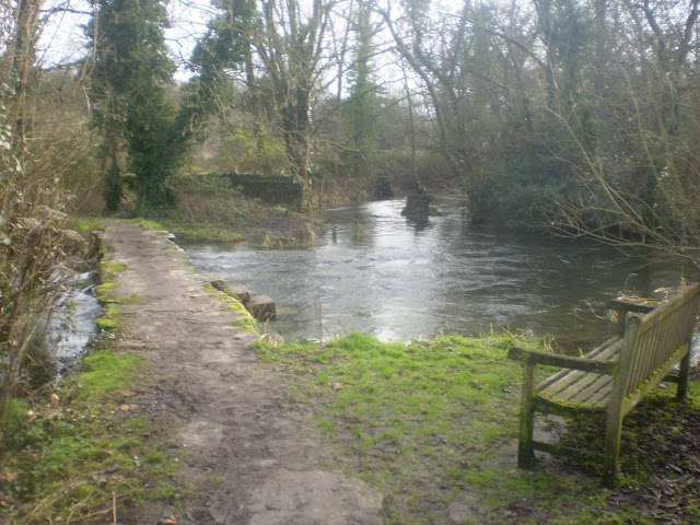 Very old footbridge over the river Leach
